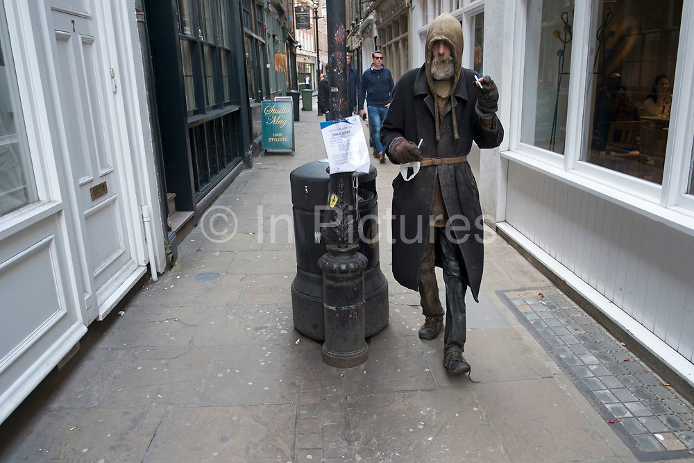 This man has been living homeless on the streets of the City of London for many years, he once used to work in the City but in his own words fell foul to management restructuring and can now be seen on the same streets wearing exactly the same clothes every day, which have now worn to a shine, London, United Kingdom.