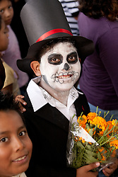 North America, Mexico, Oaxaca Province, Oaxaca, boy in costume for Day of the Dead (Dias de los Muertos) celebration