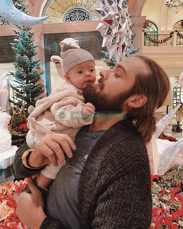 """Hana Nitsche releases a photo on Instagram with the following caption: """"Daddy\u2019s Girl. \u2764\ufe0f\ud83d\ude18 How I love to see these two. It\u2019s just so beautiful to watch them cuddle, goof around,  just be this awesome duo. Melts my heart each time. So thankful to have a partner who is such a great dad to our little girl. We both definitely had to grow into this new role and we are learning new things every day. But our bundle of love is so beautiful and precious and such a happy baby. And her daddy contributes to that. A fathers love is just so priceless. So thank you @cwshowtime for being her hero. \u2764\ufe0f\u2764\ufe0f\u2764\ufe0f\ud83d\ude4f #daddysgirl #daddyisthebest #familybound"""". Photo Credit: Instagram *** No USA Distribution *** For Editorial Use Only *** Not to be Published in Books or Photo Books ***  Please note: Fees charged by the agency are for the agency's services only, and do not, nor are they intended to, convey to the user any ownership of Copyright or License in the material. The agency does not claim any ownership including but not limited to Copyright or License in the attached material. By publishing this material you expressly agree to indemnify and to hold the agency and its directors, shareholders and employees harmless from any loss, claims, damages, demands, expenses (including legal fees), or any causes of action or allegation against the agency arising out of or connected in any way with publication of the material."""