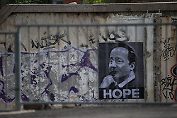 "© Licensed to London News Pictures . 23/05/2015 . Manchester , UK . A poster featuring an image of David Cameron pointing a gun in to his mouth , with the caption "" HOPE "" , pasted on a graffiti covered wall in a car park in central Manchester . Photo credit : Joel Goodman/LNP"