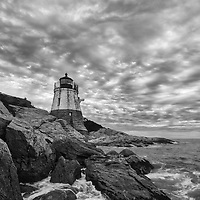 New England Black and white photography of Castle Hill Lighthouse photographed minutes before sunset. This iconic Rhode Island lighthouse is located at Narragansett Bay in Newport, RI.<br />