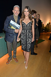ELIZABETH HURLEY and PATRICK COX at a party to celebrate the publication of Capability Brown & Belvoir - Discovering a lost Landscape by The Duchess of Rutland, held at Christie's, 8 King Street, St.James, London on 7th October 2015.