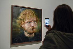 May 3, 2017 - London - A visitor to the National Portrait Gallery photographs a newly acquired portrait of the popular singer-songwriter Ed Sheeran, by artist Colin Davidson.  The 4ft x 4ft painting oil painting is the first portrait painted of the singer since the start of his professional career and has just been put on public display. (Credit Image: © Stephen Chung/London News Pictures via ZUMA Wire)