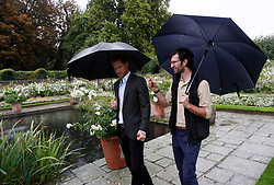Prince Harry (left) is shown around the White Garden in Kensington Palace, London, during a visit to meet representatives from charities supported by Diana, the Princess of Wales.