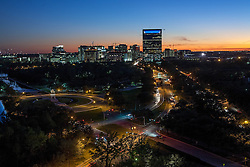 Downtown Houston, Texas skyline at sunset featuring Memorial Hermann Medical Plaza with traffic on Fannin Street in foreground.