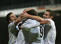 Photo: Lee Earle.<br /> Portsmouth v Chelsea. The Barclays Premiership.<br /> 26/11/2005. Chelsea's Jole Cole (L) and Frank Lampard (R) congratulate Hernan Crespo after he opened the scoring.