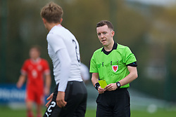 NEWPORT, WALES - Monday, October 14, 2019: Austria's Paul Koller is shown a yellow card by referee Jordan Harman during an Under-19's International Friendly match between Wales and Austria at Dragon Park. (Pic by David Rawcliffe/Propaganda)