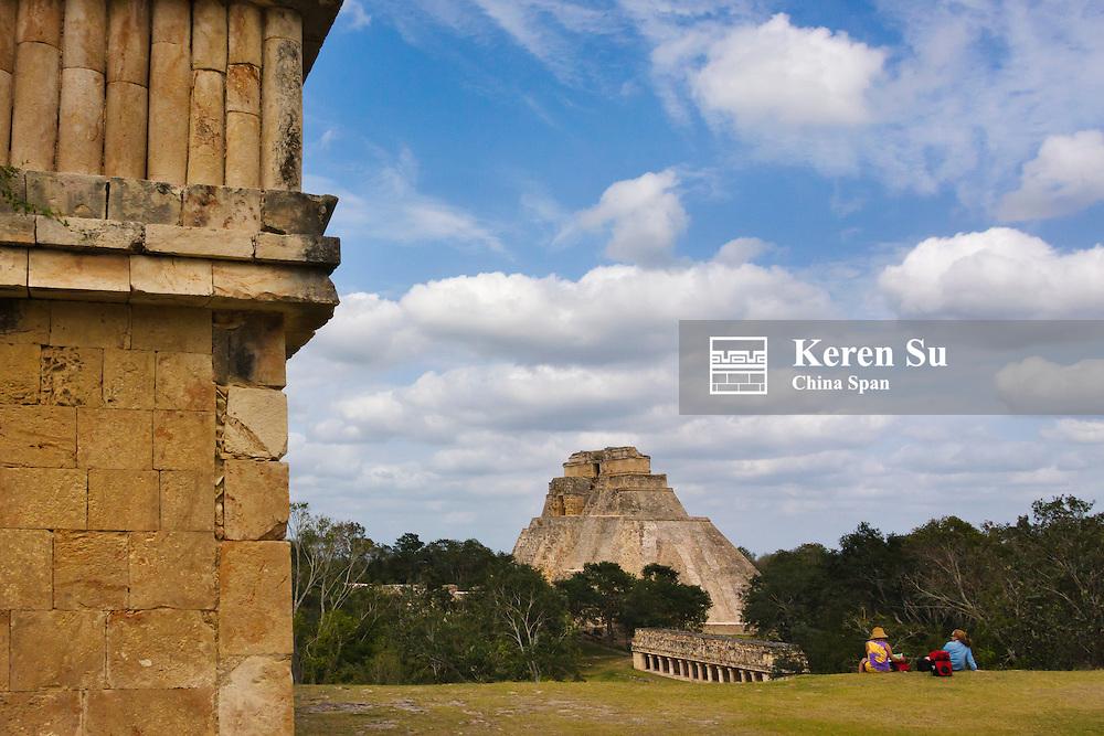 Tourists watching the Magician Pyramid, Uxmal, Yucatan, Mexico