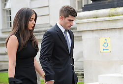 © Licensed to London News Pictures. 4/10/2016. Cardiff, UK.  Footballer Ched Evans, with his girlfriend returns to Cardiff Crown court for the afternoon session on the first day of a rape trial. Following his previous conviction which was quashed by the court of appeal. Photo credit: Jeff Thomas/LNP