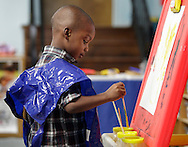 Jeremiah Farmer paints during a Head Start class at North Congregational Church in Middletown on Sept. 25, 2012.