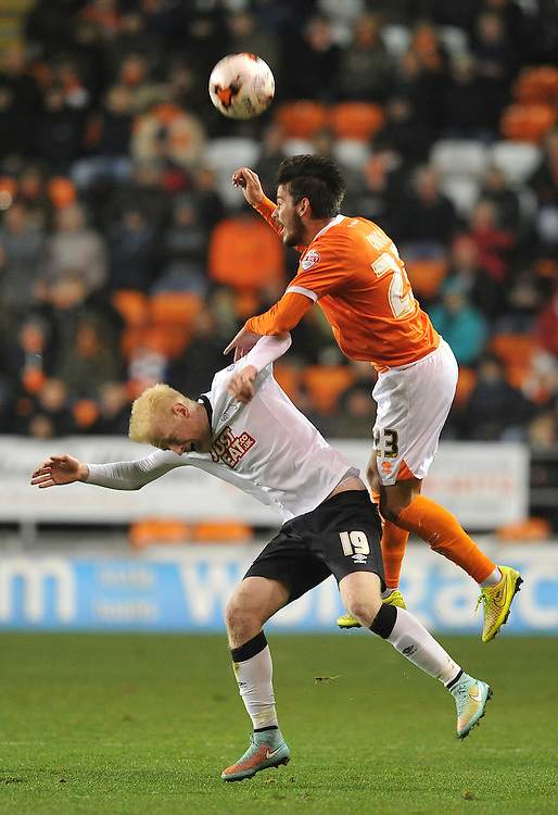 Blackpool's Edu Oriol out jumps Derby County's Will Hughes<br /> <br /> Photographer Dave Howarth/CameraSport<br /> <br /> Football - The Football League Sky Bet Championship - Blackpool v Derby County - Tuesday 21st October 2014 - Bloomfield Road - Blackpool<br /> <br /> © CameraSport - 43 Linden Ave. Countesthorpe. Leicester. England. LE8 5PG - Tel: +44 (0) 116 277 4147 - admin@camerasport.com - www.camerasport.com