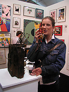 Liz Shaw using the lobster phone, The Affordable Art Fair private view ( in aid of Barnados) Battersea. 19 March 2003. © Copyright Photograph by Dafydd Jones 66 Stockwell Park Rd. London SW9 0DA Tel 020 7733 0108 www.dafjones.com