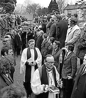 The Church of Ireland Bishop of Clogher, Dr R W Heavener, followed by the local clergyman, Rev T J Gray, head the funeral cortege of Senator Billy Fox, 35 years, Protestant, Fine Gael politician, Co Monaghan, Rep of Ireland, 14th March 1974 as it arrives Aughamullen Parish Church, Castleblaney. Fox was previously a TD (Irish MP).  He was visiting the home near Clones of his fiancee, Marjorie Coulson, which unknown to him had been taken over by thirteen armed paramilitaries. He ran from the scene but was followed and shot dead in a nearby field. Five members of the Provisional IRA were subsequently tried and convicted of the killing. 197403140164f.<br /> <br /> <br /> Copyright Image from Victor Patterson, Belfast, UK<br /> <br /> t: +44 28 9066 1296 (from Rep of Ireland 048 9066 1296)<br /> m: +44 7802 353836<br /> e: victorpattersonbelfast@gmail.com<br /> <br /> www.images4media.com<br /> <br /> Please see my full Terms and Conditions of Use at https://www.images4media.com/p/terms-conditions - it is IMPORTANT that you familiarise yourself with them.<br /> <br /> Images used online incur an additional cost. This cost should be agreed in writing in advance. Online images must be visibly watermarked i.e. © Victor Patterson or that of the named photographer within the body of the image. The original metadata must not be deleted from images used online.<br /> <br /> This image is only available for the use of the download recipient i.e. television station, newspaper, magazine, book publisher, etc, and must not be passed on to a third party. It is also downloaded on condition that each and every usage is notified within 7 days to victorpattersonbelfast@gmail.com.<br /> <br /> The right of Victor Patterson (or the named photographer) to be identified as the author is asserted in accordance with The Copyright Designs And Patents Act (1988). All moral rights are asserted.