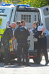 ©Licensed to London News Pictures 20/04/2020  <br /> Charlton, UK. Police take a man away in handcuffs. Metropolitan police officers surrounded a property near Charlton football club, Charlton, South East London today to arrested a suspect. The man who is believed to have been running from police was trapped in a back garden by at least ten armed police officers and a police dog.<br />  Reports on social media show footage of a white van in a high speed pursuit, it is not confirmed to be linked to this incident at the present time. Photo credit:Grant Falvey/LNP