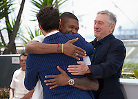 Usher Raymond IV embracing actor Édgar Ramírez, and Robert De Niro and at the Hands Of Stone film photo call at the 69th Cannes Film Festival Monday 16th May 2016, Cannes, France. Photography: Doreen Kennedy