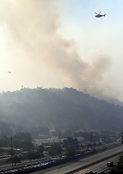 Fire firefighters continue to battle the massive Woolsey fire from the air in Calabasas California across from Kim Kardashian's home in Hidden Hills shutting down the US 101 Freeway in both directions in Calabasas on Saturday afternoon. The fire is threatening thousands of homes and is directly above a few high end car dealerships at the moment. Firefighters are hoping to stop it before it destroys the car dealerships and many resident's homes in the area including many celebrities. 10 Nov 2018 Pictured: Woosley Fire in Hidden Hills. Photo credit: GAC / MEGA TheMegaAgency.com +1 888 505 6342