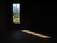 morning light through a window in an old cabin at Cade's Cove, Great Smoky Mountains National Park, Tennessee, USA