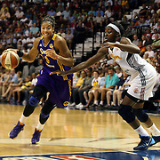 Candace Parker, (left), Los Angeles Sparks, drives past Chiney Ogwumike, Connecticut Sun, during the Connecticut Sun Vs Los Angeles Sparks WNBA regular season game at Mohegan Sun Arena, Uncasville, Connecticut, USA. 3rd July 2014. Photo Tim Clayton