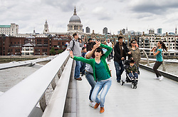 © Licensed to London News Pictures. 23/07/2012. London, UK.  Performers take part in The Bridge 2012, an interactive performance on the Millennium Bridge, London, conceived by Janine Harrington. Through a series of encounters, the work invites passersby to explore their relationships to the performers - as audience, and as collaborators. Picture shows: Photo credit : Tony Nandi/LNP