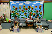 At a senior center in the small city of Nago, Okinawa, elderly Japanese can spend the day in a setting reminiscent of a spa, taking foot baths, enjoying deep-water massage, and lunching with friends. With their caring, community-based nursing and assistance staff, Okinawan nursing homes and senior daycare centers, both public and private, seem wondrous, vibrant and lively places. Hungry Planet: What the World Eats (p. 193).