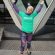 London, England, UK. Eva Bajbrova is a fitness instrator warming up runners for The Gherkin Challenge at the The Gherkin rise fund for NSPCC help children across the UK to rebuild their lives.
