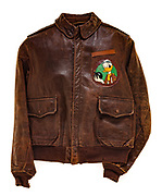 This type A-2 flight jacket belonged to Roger Howell, a crew member attached to the 571st squadron. Prior to being transferred to the 571st Squadron of the 390th Bomb Group, Howell served in a squadron that flew the B-26 medium bomber. The insignia on the front of his jacket, a duck holding a bomb, was the insignia for his B-26 squadron.