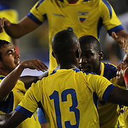 Enner Valencia, Ecuador, is congratulated by teammates after scoring during the Ecuador Vs El Salvador friendly international football match at Red Bull Arena, Harrison, New Jersey. USA. 14th October 2014. Photo Tim Clayton