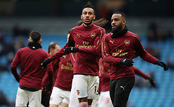 Arsenal's Pierre-Emerick Aubameyang and Arsenal's Alexandre Lacazette warm up during the Premier League match at the Etihad Stadium, Manchester.