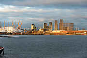 Morden Wharf and the O2 Arena in late afternoon sun, looking east from Greenwich, London, UK