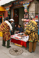 """Barkhor Square is an area of narrow streets and a public square located around Jokhang Monastery in Lhasa. <br /> Barkor Square has been the most important devotional place for a circumabulation or """"kora"""" for Tibetan pilgrims for centuries.  Most of the alleys have been demolished in recent years and replaced with wider streets by the Chinese government."""