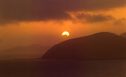 NEW YEARS EVE ON BLASKET ISLANDS...<br /> The sun sinks slowly behind the clouds and the Great Blasket Islands near Dingle in Co. Kerry at 4.36pm on New Years Eve marking one of the last sunset views of the second millennium <br /> Picture by Don MacMonagle