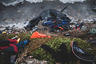 Scores of life jackets, as well as the remains of inflatable boats, lie abandoned on a beach in Lesbos, Greece, after refugees and migrants arrived from Turkey on their way to other destinations in Europe. (October 23, 2015)