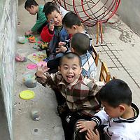 Asia, China, Beijing. Chinese kindergarten children with playdoh.
