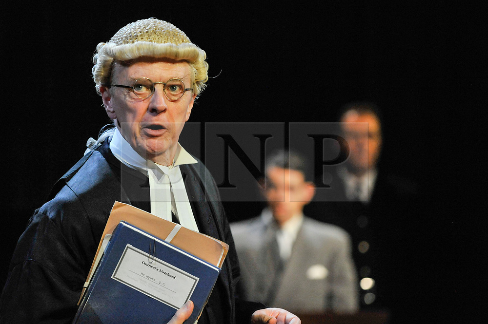 """© Licensed to London News Pictures. 20/10/2017. London, UK. Philip Franks as Mr Myers QC addresses Jack McMullen as Leonard Vole, the accused.  Photocall for """"Witness for the Prosecution"""", by Agatha Christie, directed by Lucy Bailey, at London County Hall.  The play opens 23 October. Photo credit : Stephen Chung/LNP"""