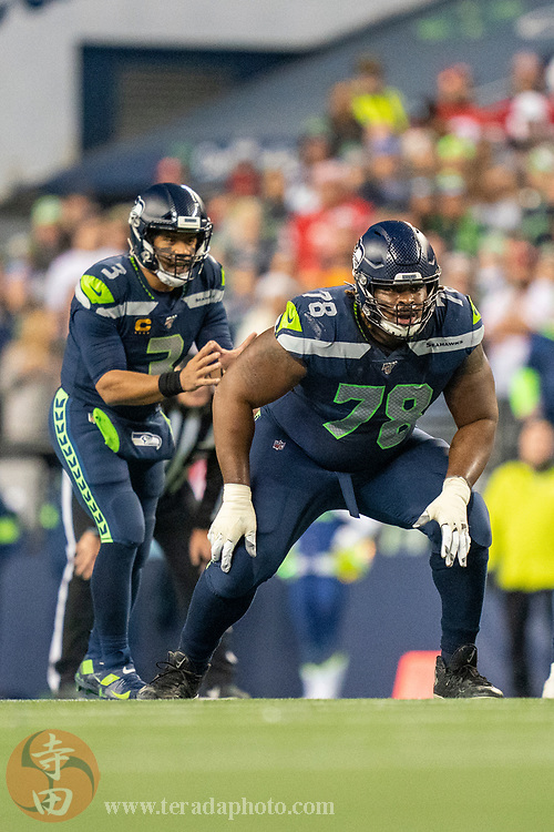 December 29, 2019; Seattle, Washington, USA; Seattle Seahawks offensive guard D.J. Fluker (78) in front of quarterback Russell Wilson (3) during the second quarter against the San Francisco 49ers at CenturyLink Field.