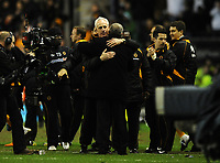 Football - Premier League - Wolverhampton Wanderers vs. Manchester United<br /> A jubilant Mick McCarthy of Wolves hugs Sir Alex Ferguson Manager of Manchester United at the final whistle having seen his team win 2-1 at Molineux Stadium, Wolverhampton