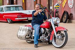 "Craig Gacom on his Shovelhead at his ""Rusty Ranch"" on Thursday of Arizona Bike Week 2014. USA. April 4, 2014.  Photography ©2014 Michael Lichter."