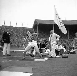 Jaroslava Komarkova of Czechoslovakia putting the shot.