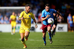 Matt Taylor of Bristol Rovers is chased by Murray Wallace of Scunthorpe United  - Mandatory by-line: Matt McNulty/JMP - 06/08/2016 - FOOTBALL - Glanford Park - Scunthorpe, England - Scunthorpe United v Bristol Rovers - Sky Bet League One