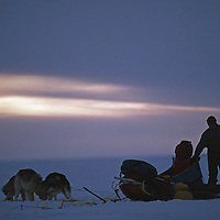 Northwest Territories, Canada. A dogsledding expedition sets up camp on Great Slave Lake.