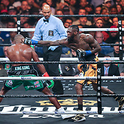 Deontay Wilder (R) fights against Luis Ortiz during the WBC Heavyweight Championship boxing match at Barclays Center on Saturday, March 3, 2018 in Brooklyn, New York. Wilder would win the bout by knockout in the tenth round to retain the title and move to 40-0. (Alex Menendez via AP)