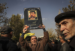 TEHRAN, Nov. 27, 2015 (Xinhua) -- An Iranian mourner holds up a poster of Iran's former ambassador to Lebanon Ghazanfar Roknabadi, who died in the Hajj stampede in Saudi Arabia in September, during his funeral in Tehran, capital of Iran, on Nov. 27, 2015. (Xinhua/Ahmad Halabisaz) (Credit Image: © Ahmad Halabisaz/Xinhua via ZUMA Wire)