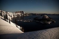 Wizard Island and the west side of crater lake bask in the brightest full moon of the year.