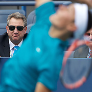 Australian Tennis Officials Steve Wood (left) and Geoff Pollard watching Bernard Tomic, Australia, in action against Alexander Domijan, USA, in the Boy's Singles Championships during the US Open Tennis Tournament at Flushing Meadows, New York, USA, on Wednesday, September 9, 2009. Photo Tim Clayton..