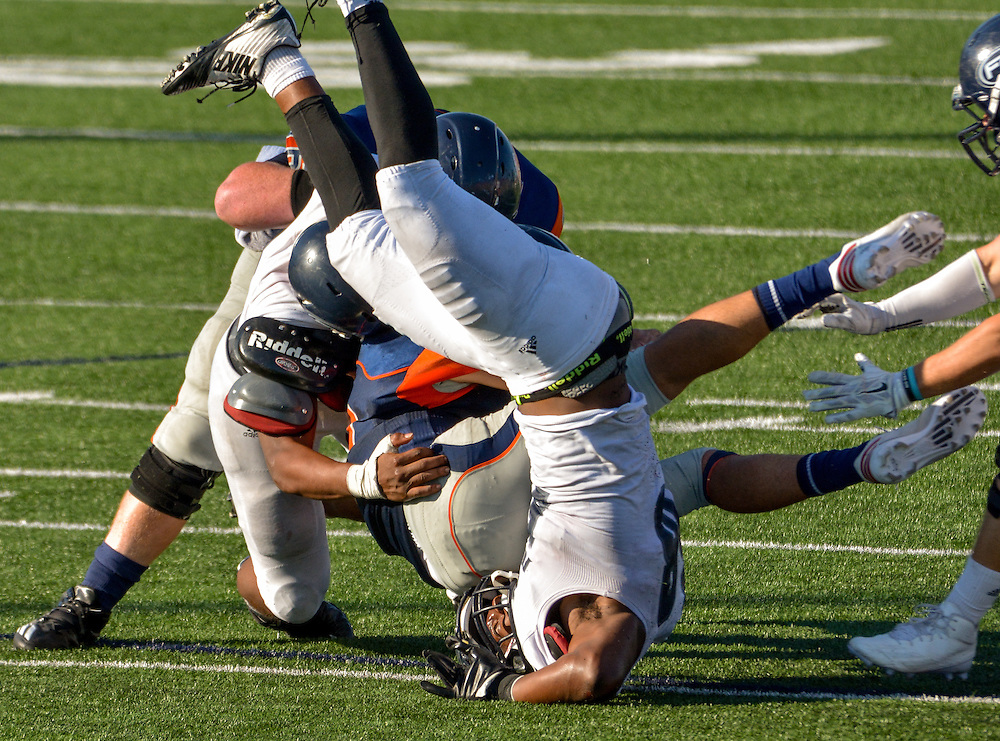 song_sat_1197- Fullerton College linebacker Tyler Stepney attempts to tackle Orange Coast College quarterback Kody Whitaker. November 5th, 2016 — Fullerton College vs Orange Coast College — Men's Football — Costa Mesa, CA<br /> <br /> Photo by Austin Song / Sports Shooter Academy 13