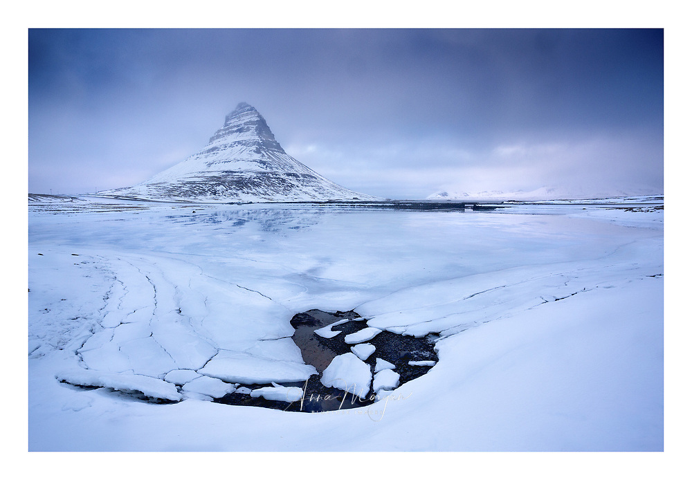 Ice floes and the base of a waterfall near Iceland's iconic Kirkjufell mountain
