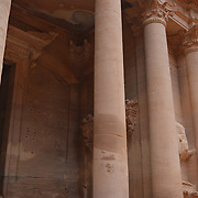 """Petra is a famous archaeological site in Jordan's southwestern desert. Dating to around 300 B.C., it was the capital of the Nabatean Kingdom. Accessed via a narrow canyon called Al Siq, it contains tombs and temples carved into pink sandstone cliffs, earning its nickname, the """"Rose City."""" Perhaps its most famous structure is Al Khazneh, a temple with an ornate, Greek-style facade."""