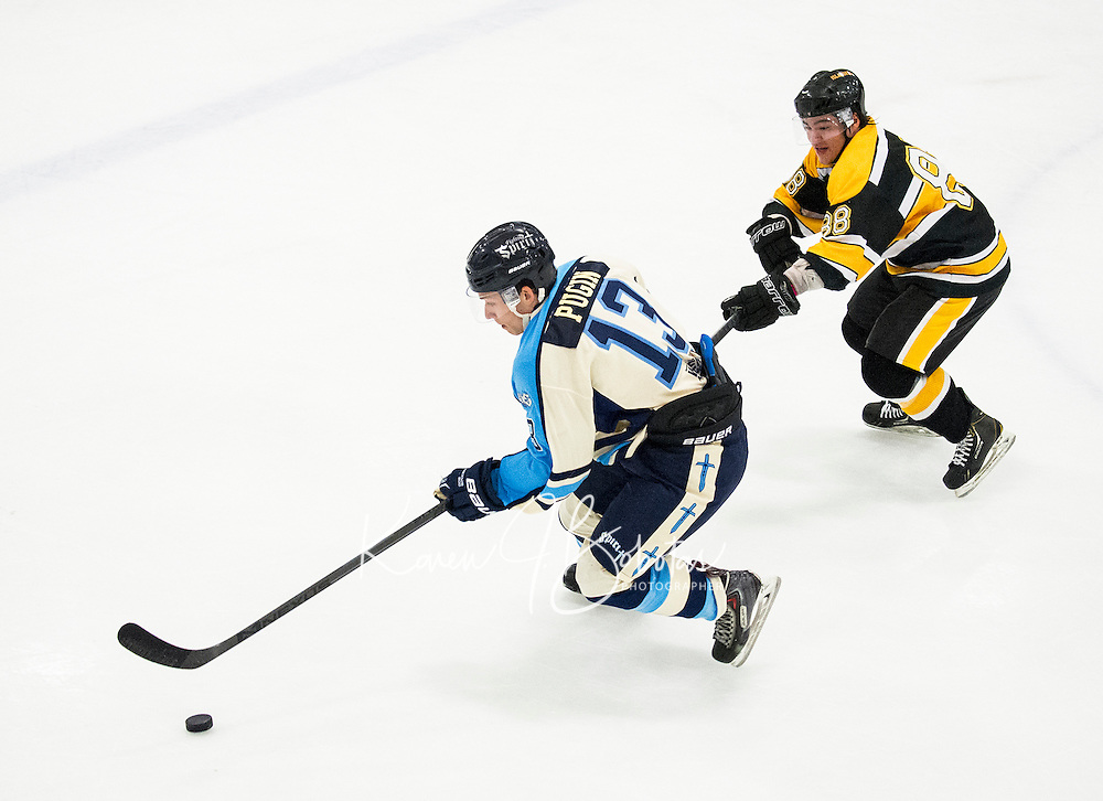 Frederic Pugin of NH's Fighting Spirit takes control of the puck against Cape Cod Islanders Alexander Klimovich during Junior A Hockey at the Laconia Ice Arena Friday evening.  (Karen Bobotas/for the Laconia Daily Sun)