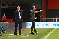 Football - 2019 / 2020 EFL Cup - Round 2 -AFC Bournemouth vs. Crystal Palace <br /> <br /> Bournemouth's Manager Jason Tindall gives some instructions to his team as Crystal Palace Manager Roy Hodgson looks on at the Vitality Stadium (Dean Court) Bournemouth <br /> <br /> COLORSPORT/SHAUN BOGGUST