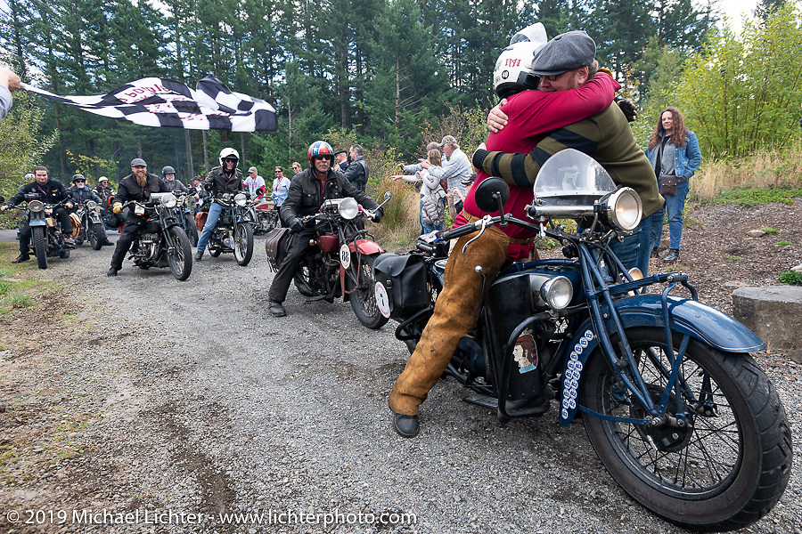 Steve Rinker on his1928 Indian Scout is greeted at the finish line by Jason Sims during the Motorcycle Cannonball coast to coast vintage run. Stage 15  (51 miles - the Grand Finish) from The Dalles to Stevenson, OR. Sunday September 23, 2018. Photography ©2018 Michael Lichter.